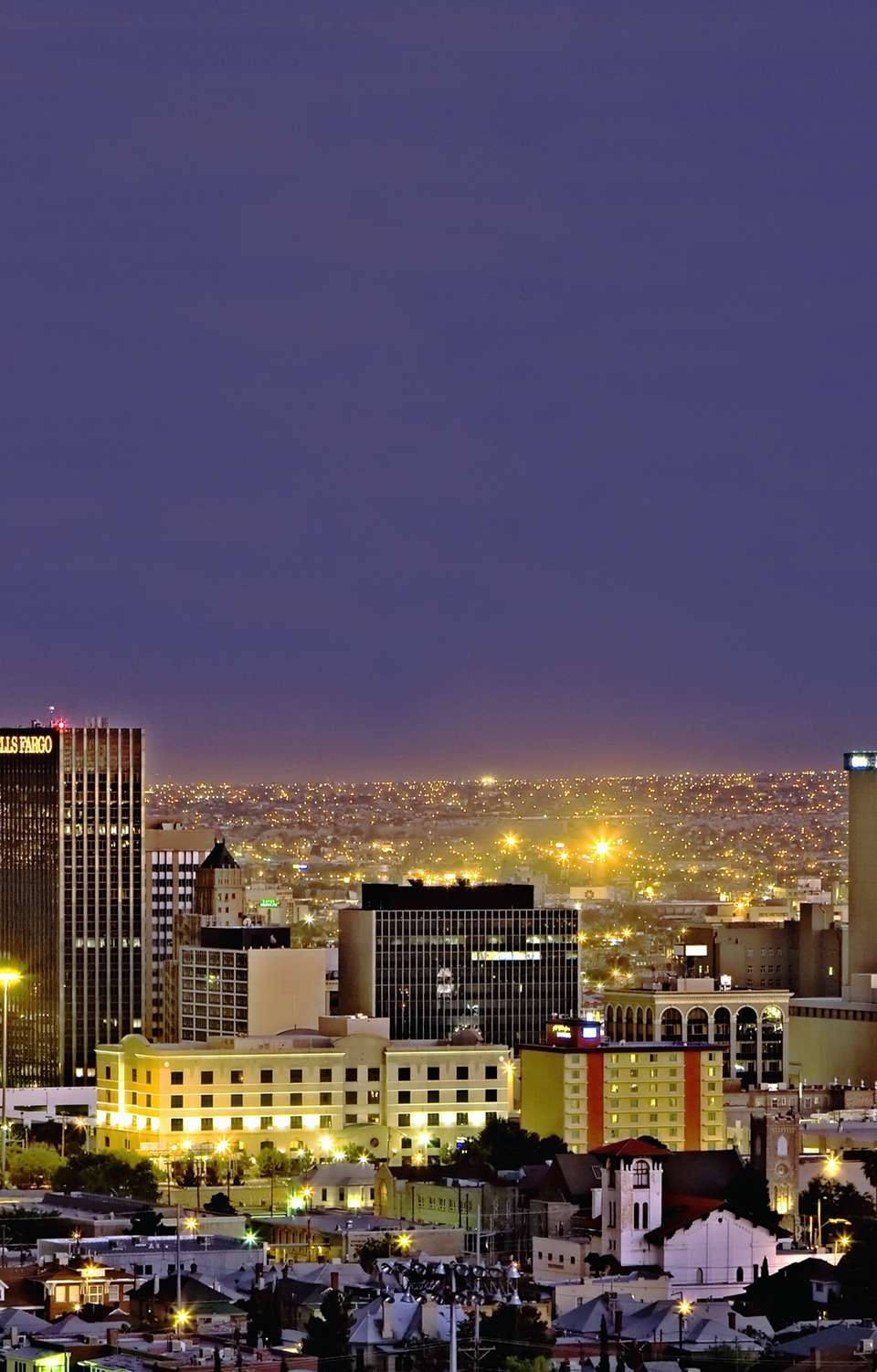 Nighttime view of El Paso, Texas with many lights and buildings