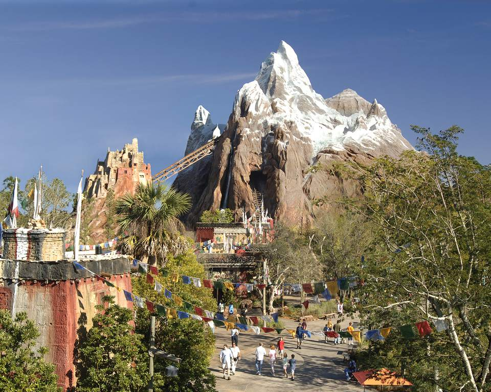 View of Expedition Everest and people in the park