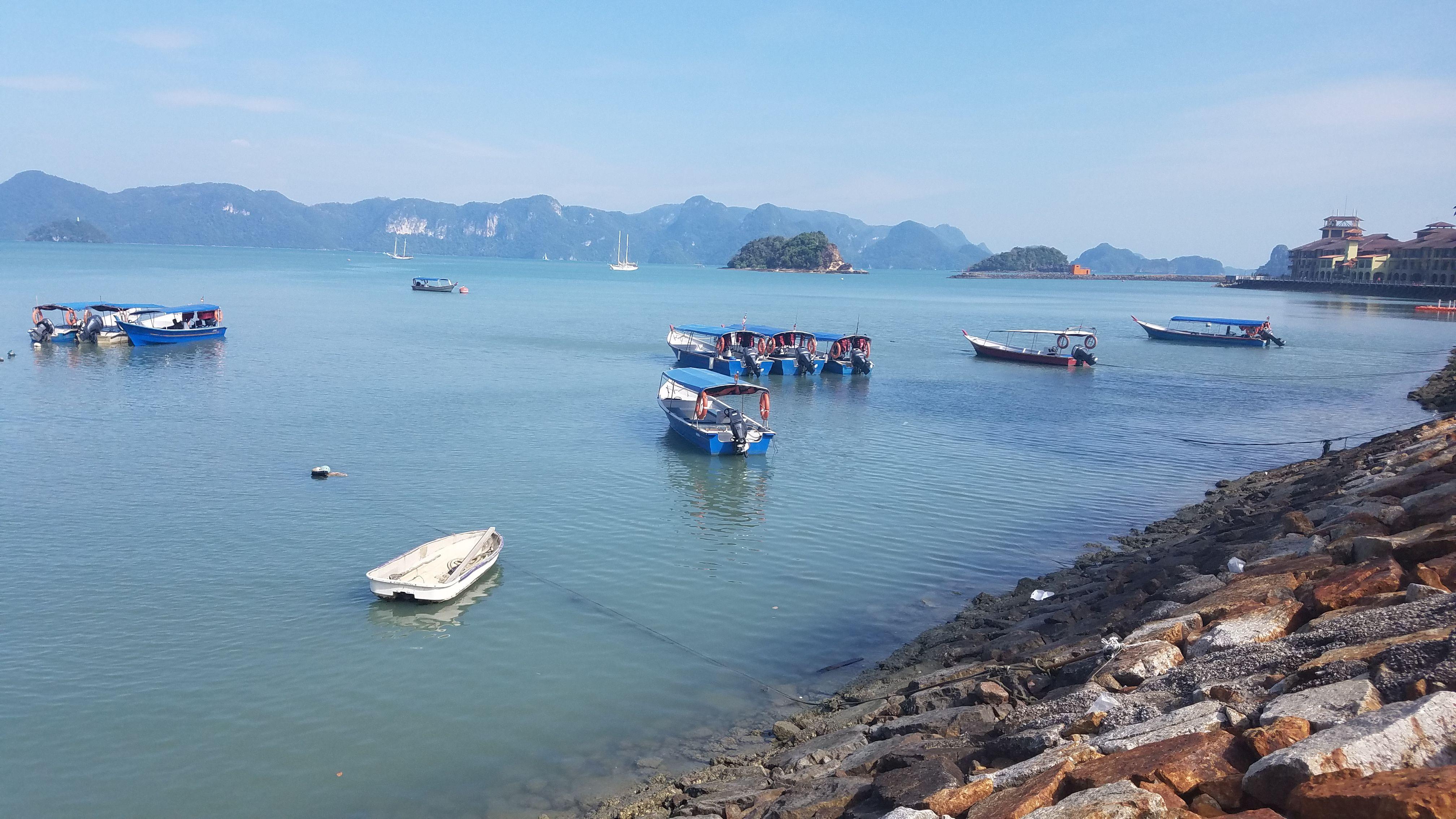 Small boats off the coastline of Pulau Langkawi, Malaysia