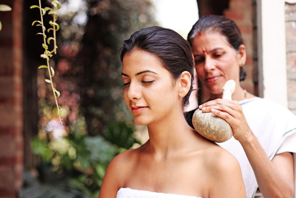 Person getting an Ayurvedic Kizhi treatment in India