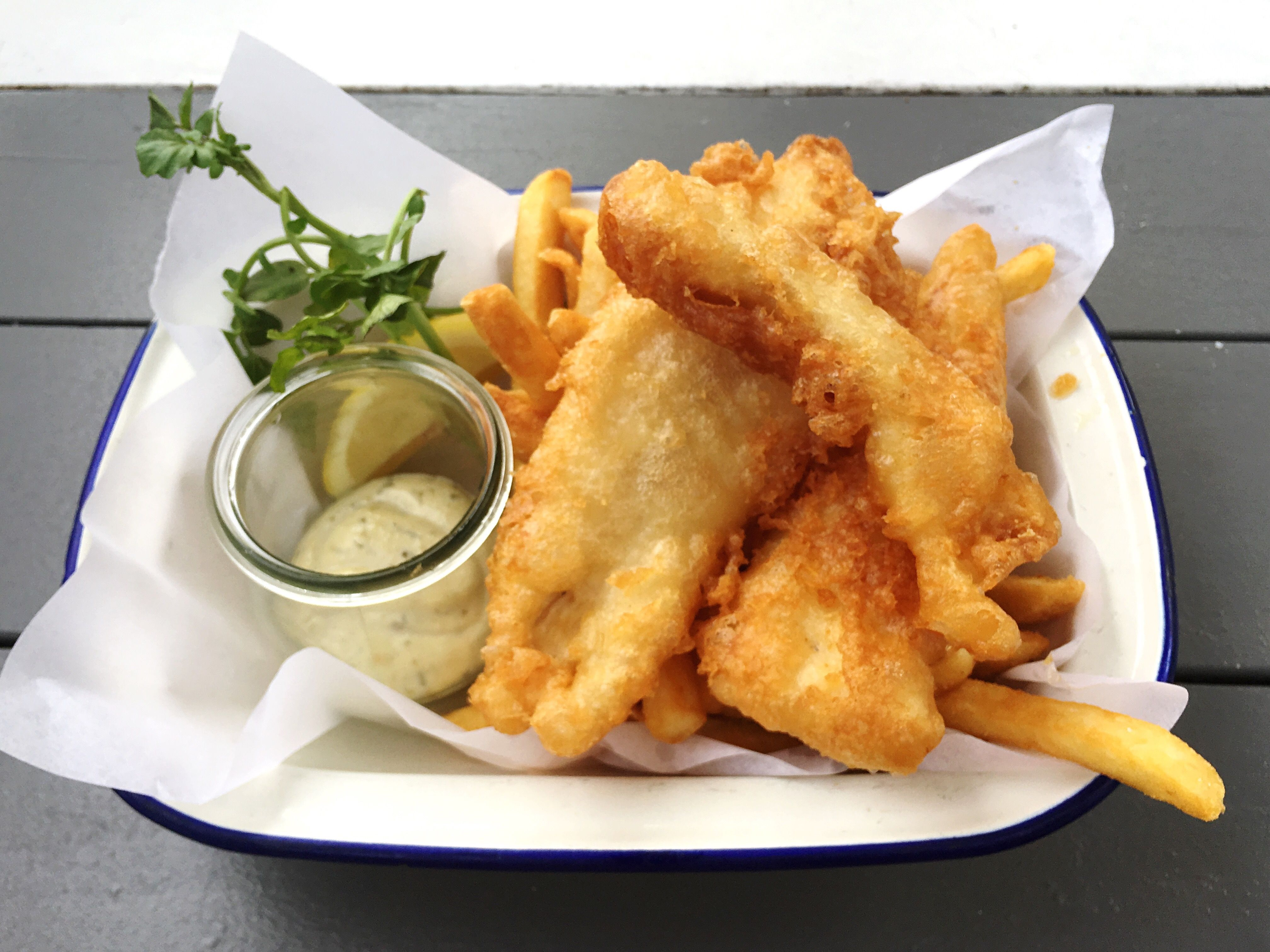 High Angle View Of Fresh Fish And Chips Served On Table