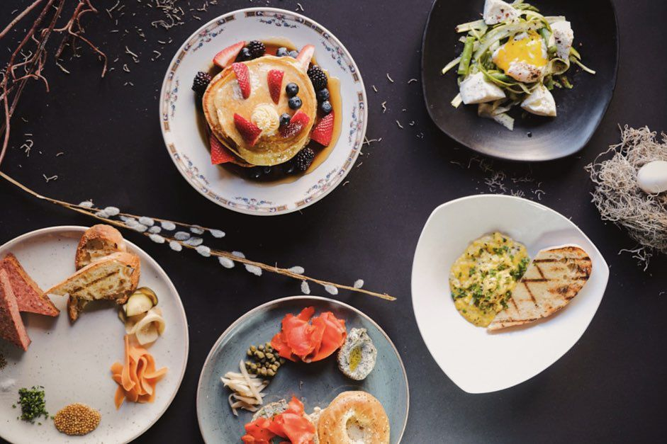 Brunch dishes laid out on a black marble tapletop