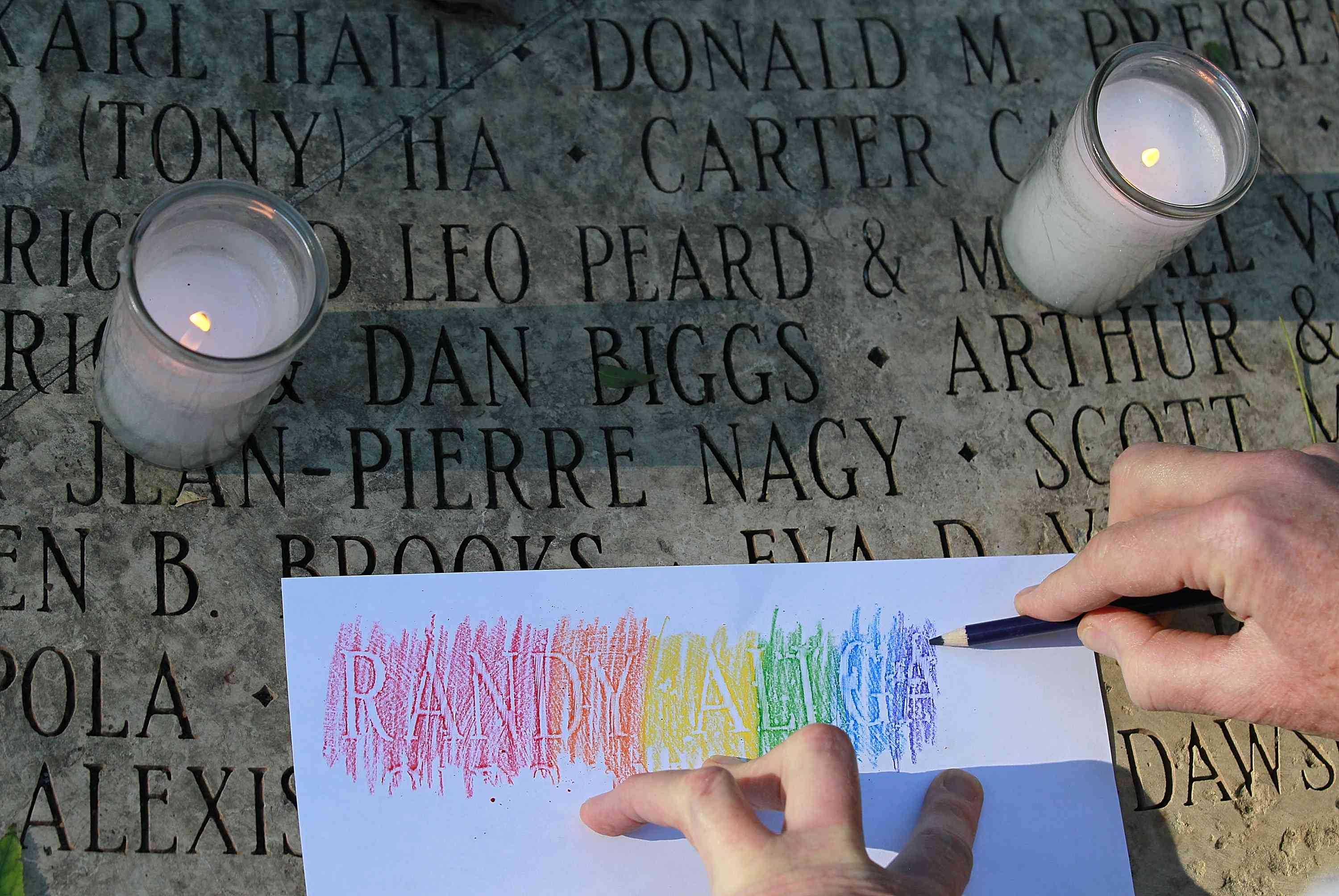 Visitors Pay Respects At AIDS Memorial On World AIDS Day