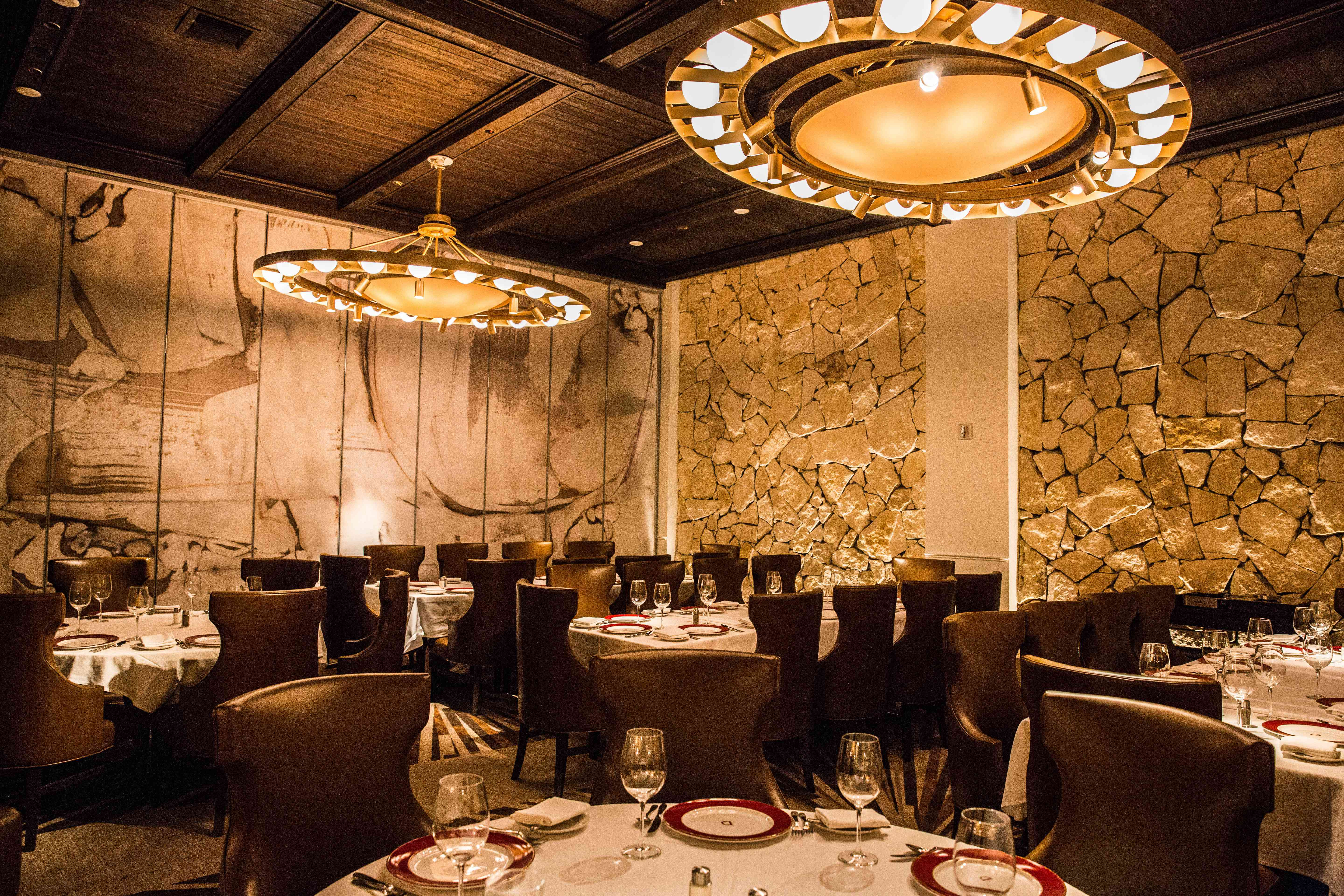 Dining room in Delmonico Steakhouse with large chandeliers
