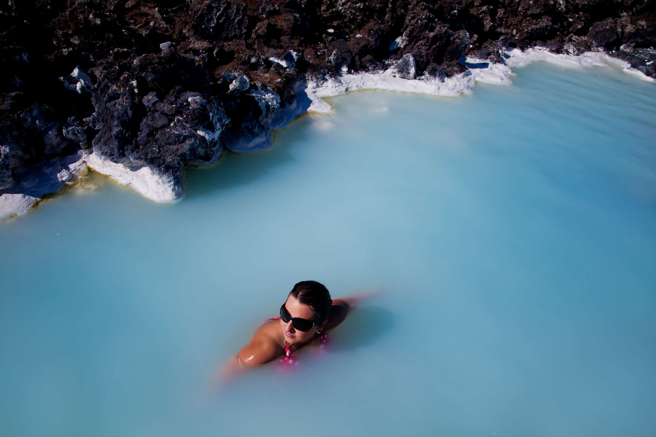 Woman enjoying the waters at the Blue Lagoon in Iceland.