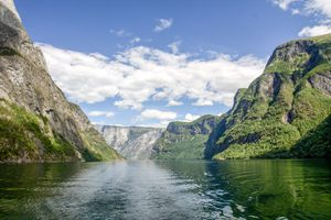 view looking up from the water at the fjord in Flam