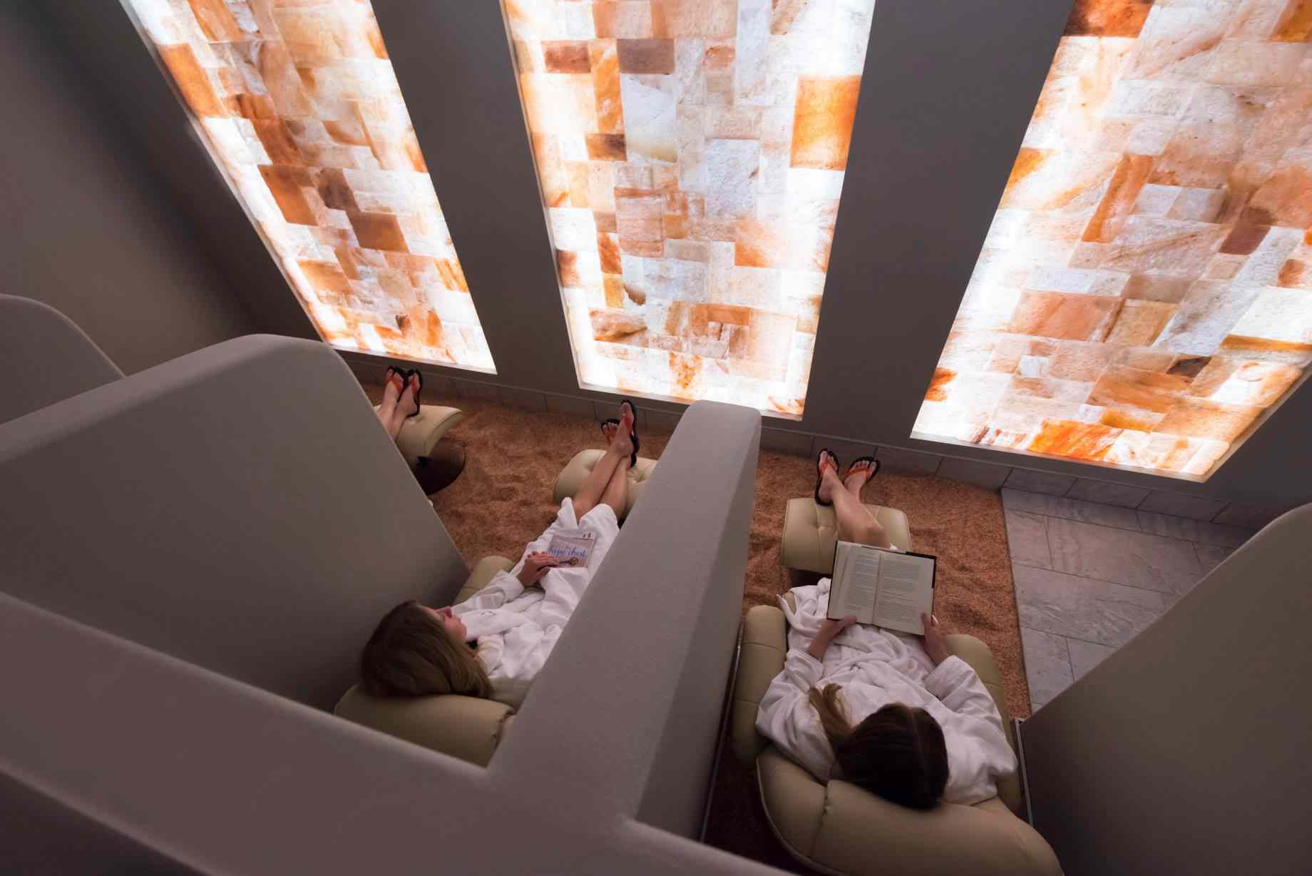 people relaxing and reading in the Sundara spa