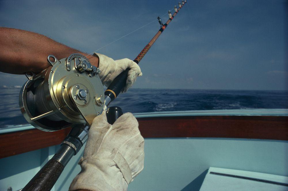 reeling in a big fish on the Riviera Maya
