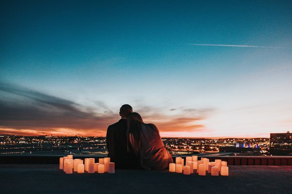 A couple watching the sunset by candlelight