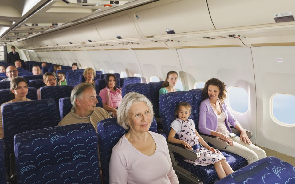 people in economy class airliner