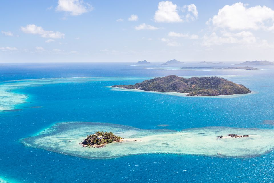 Aerial of island with tourist resort, Fiji