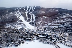 This photo shows the Mont Tremblant Village and mountain in winter.