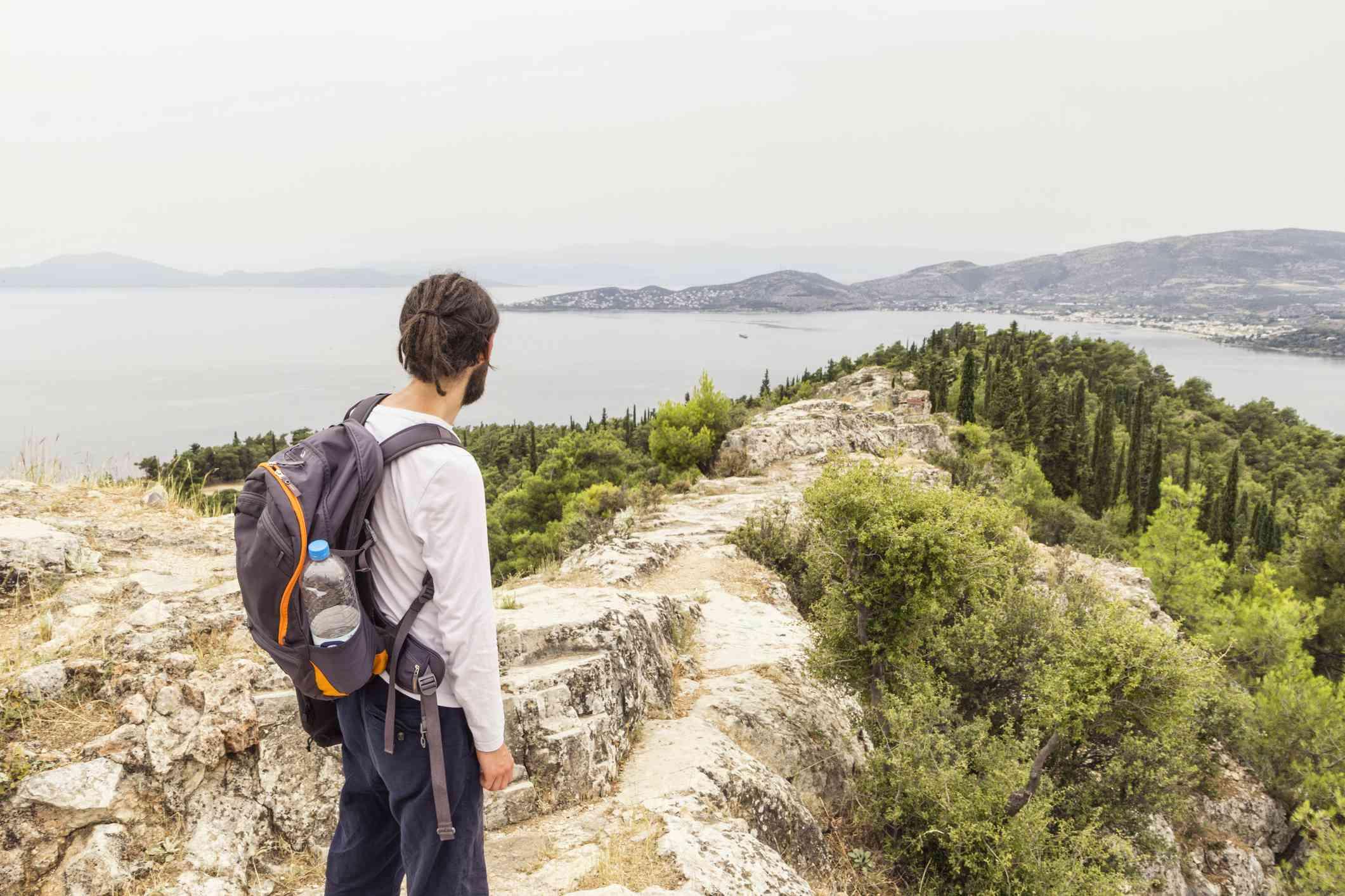 Greece, Volos, man enjoying view to Pagasetic Gulf