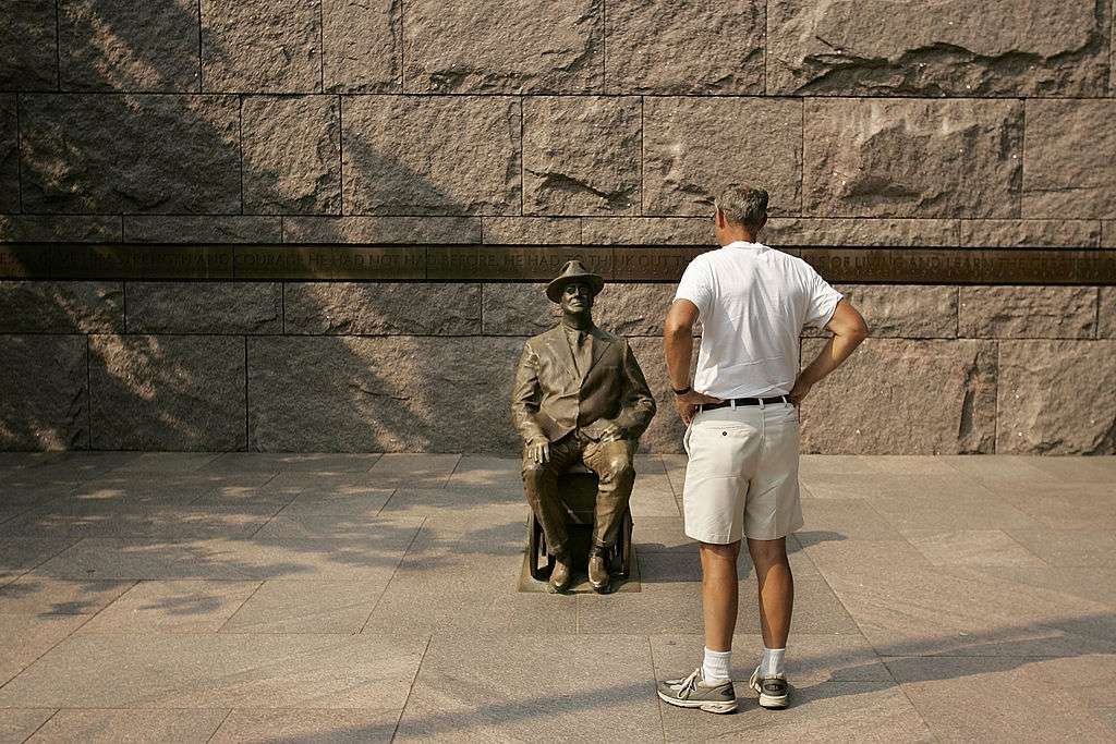 A tourist looks at one of the statues of President Franklin Delano Roosevelt at the FDR Memorial in West Potomac Park August 12, 2005 in Washington, DC. James Roosevelt, FDR's grandson and a former associate commissioner of the Social Security Administration, joined Americans United to Protect Social Security for a ceremony to kick off nationwide celebrations of the 70th anniversary of Social Security at the memorial.