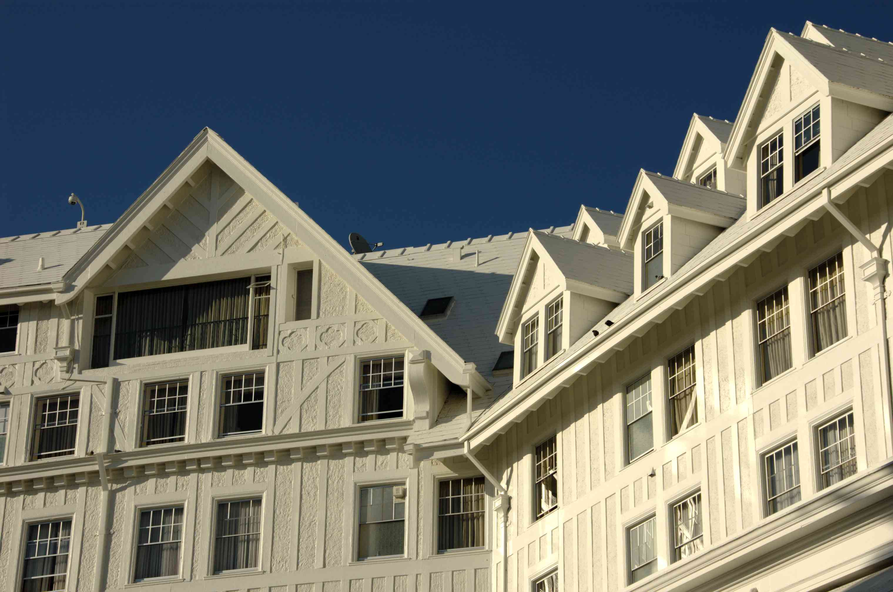 White exterior facade of the Claremont Hotel