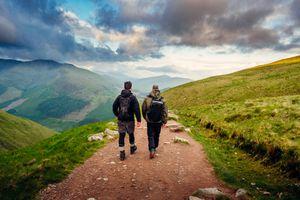 Two men hiking along a path on Ben Nevis, Scotland