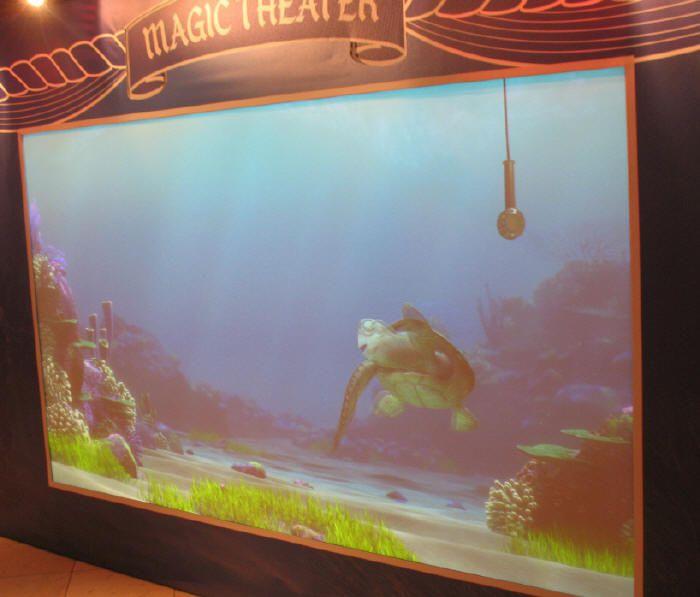 Turtle talk with Crush the turtle - Photo courtesy of Disney Cruise Line.