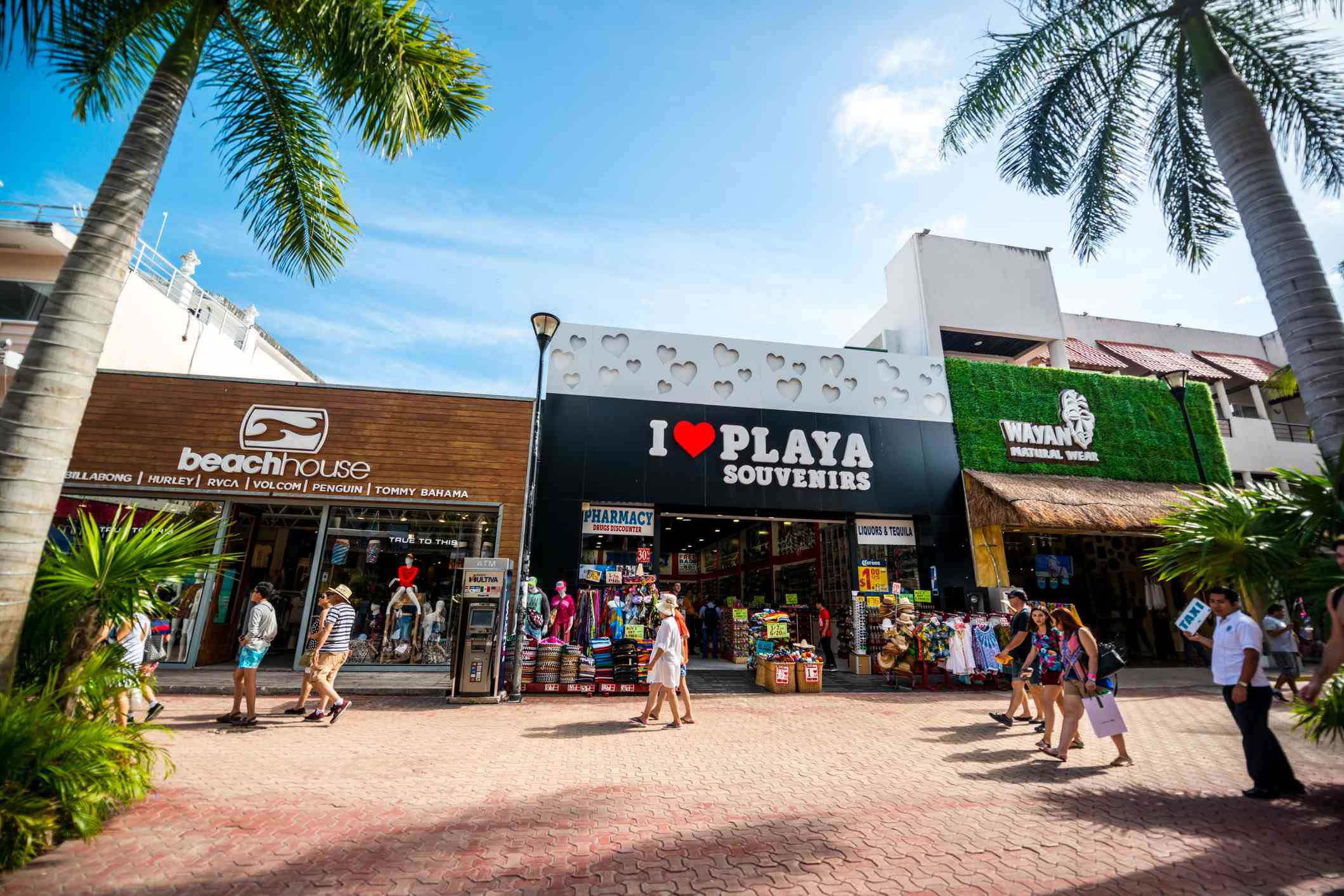 Tourists exploring famous shopping street in Playa Del Carmen - 5th Avenue, Mexico