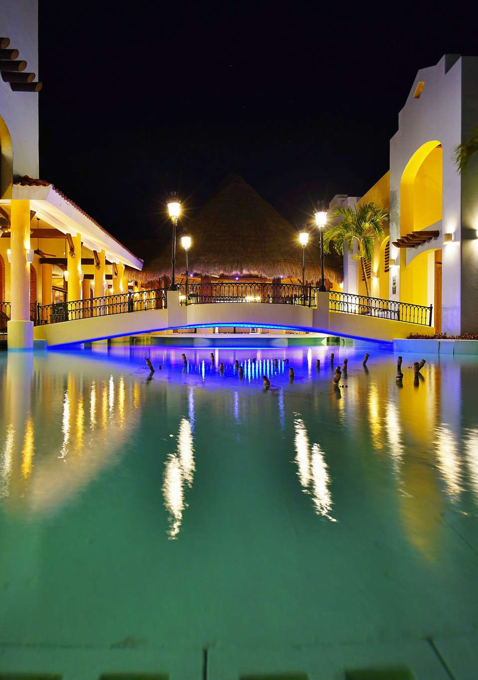 Residence buildings and a pool at the Iberostar Paraiso Lindo on the Riviera Maya.
