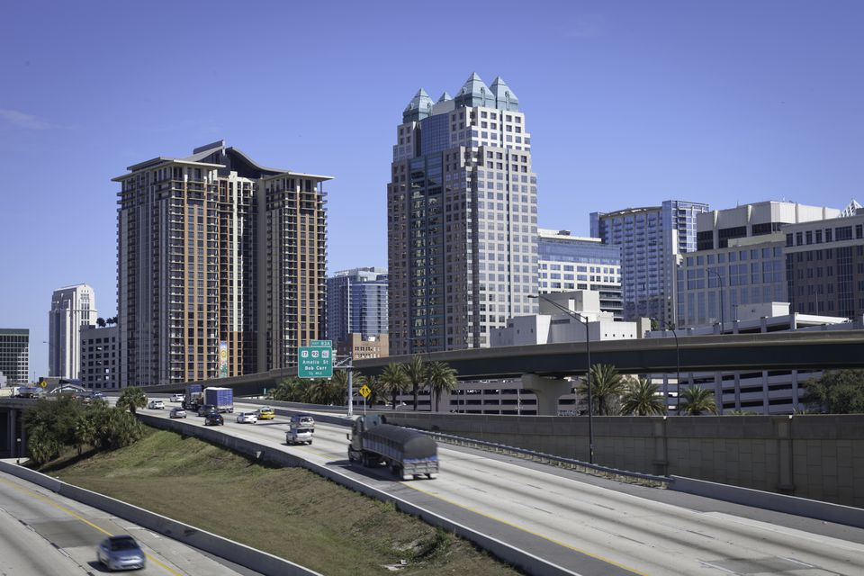 Orlando Florida skyline viewed from I-4 with a perfect blue sky in the background