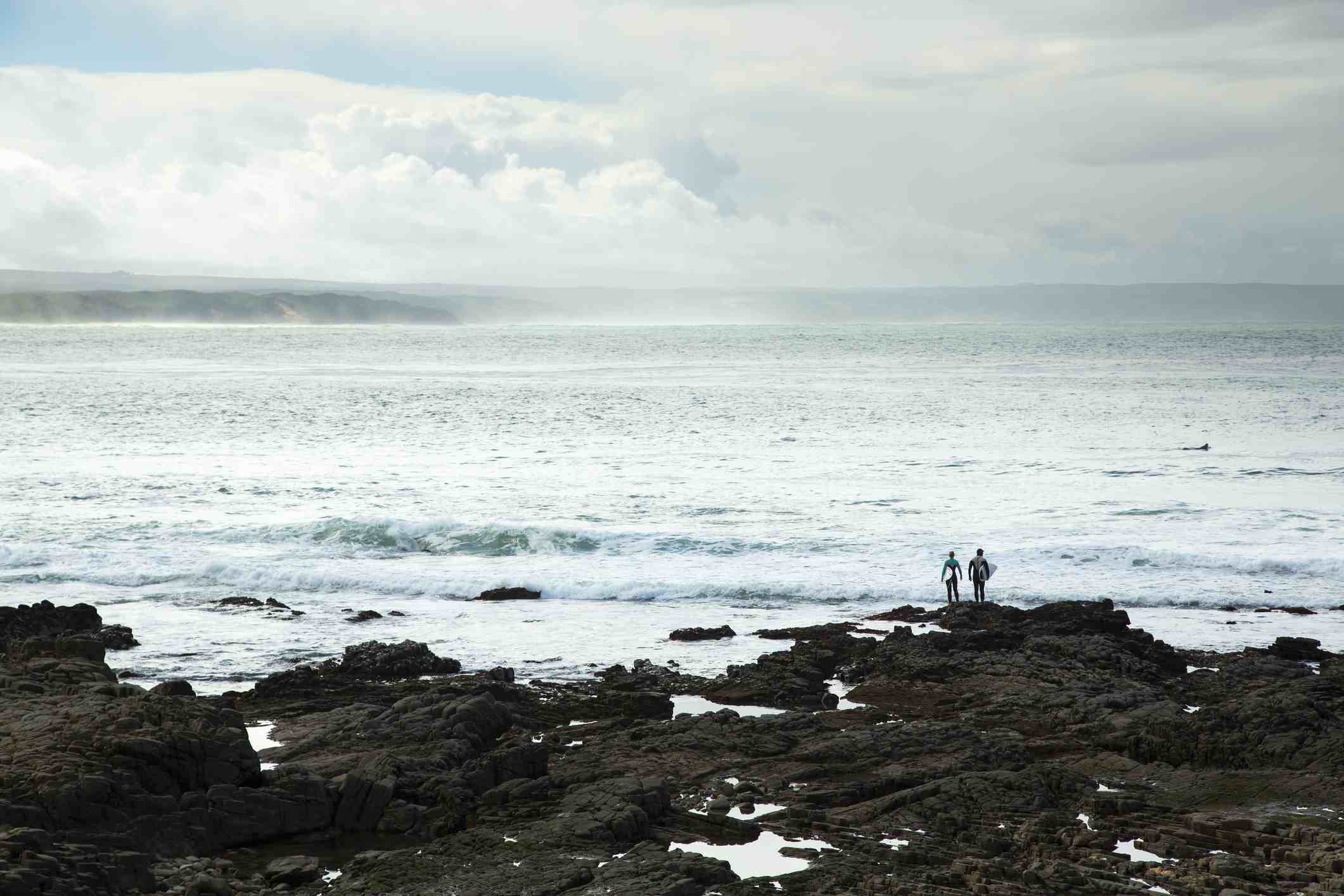 Surfers watching the sea at Stilbaai, South Africa
