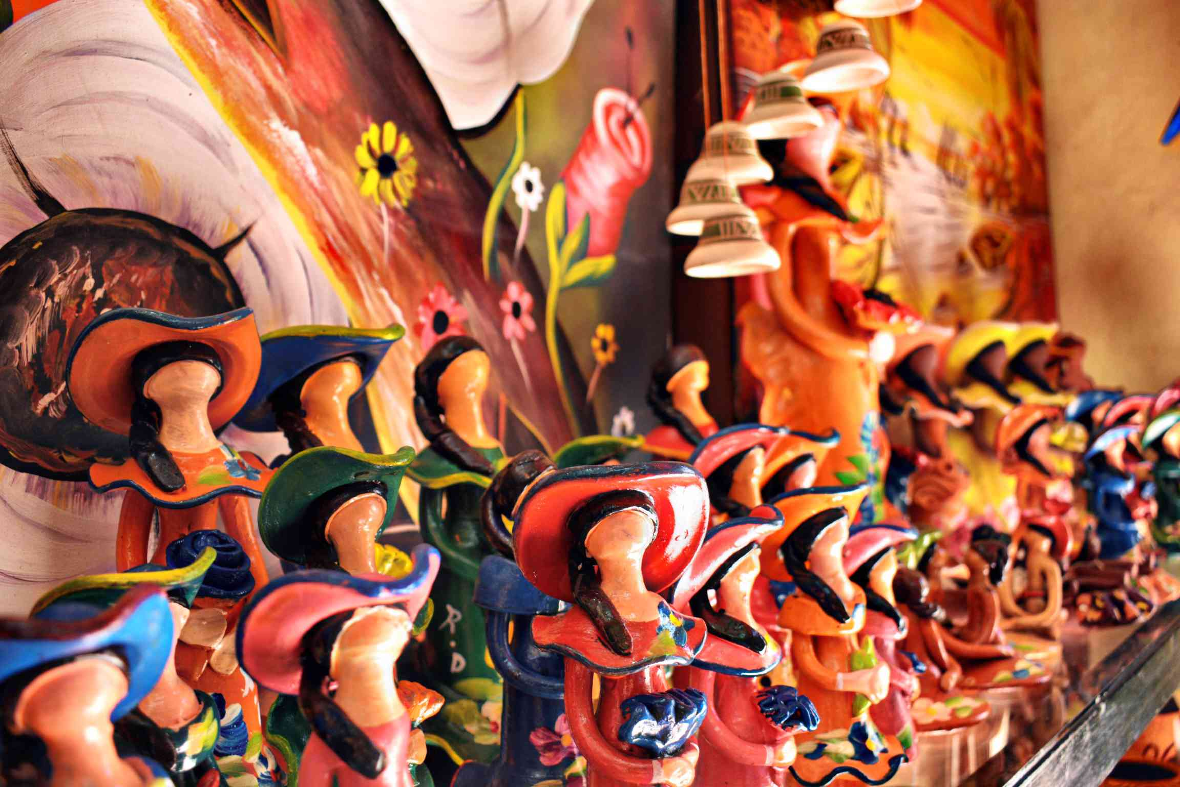 Painted figurines being sold in souvenir shops