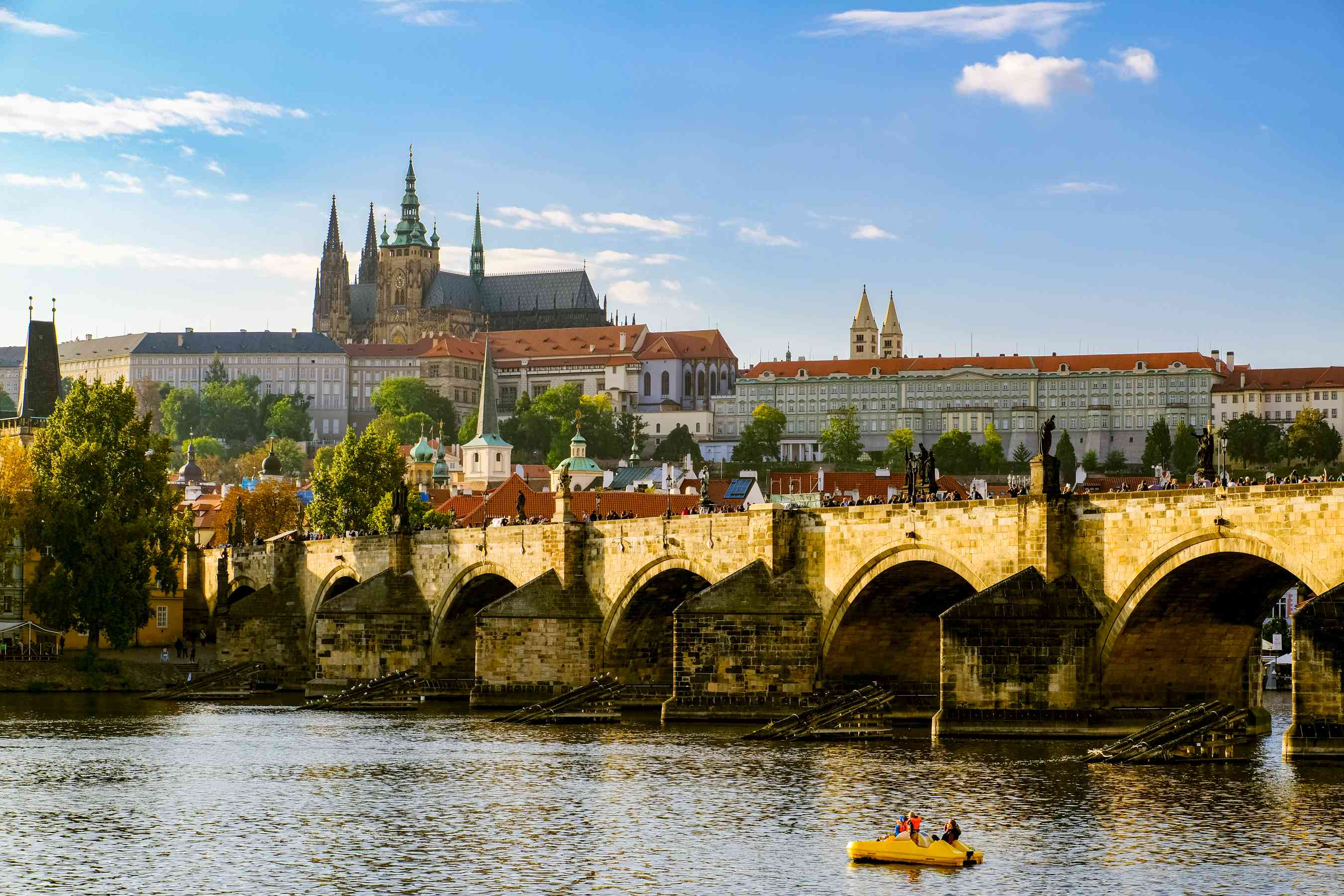 View of the Charles Bridge with the Prague Castle up on the hill behind it