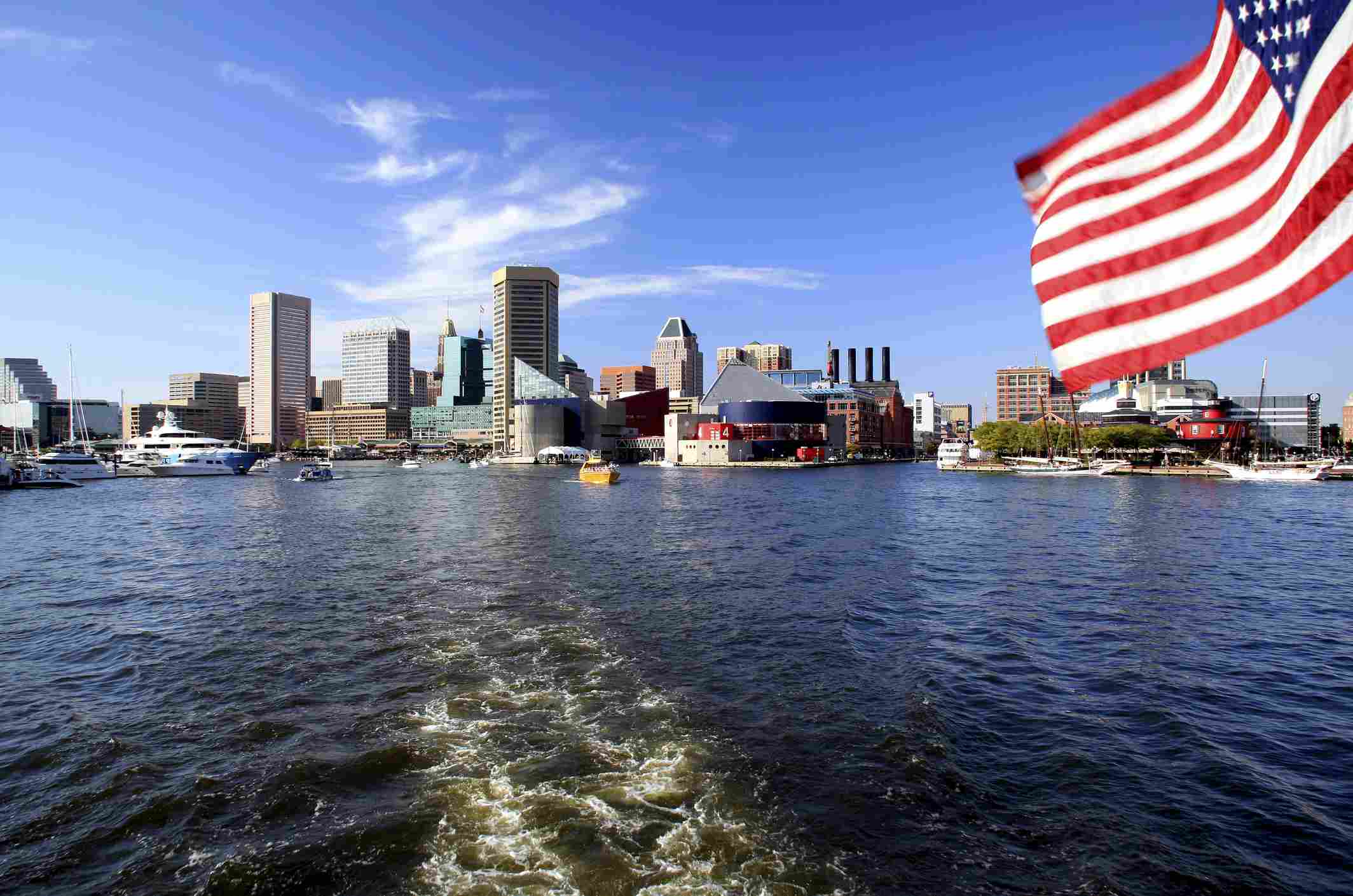 American Flag Flying Over Inner Harbor And Baltimore Skyline Maryland Usa