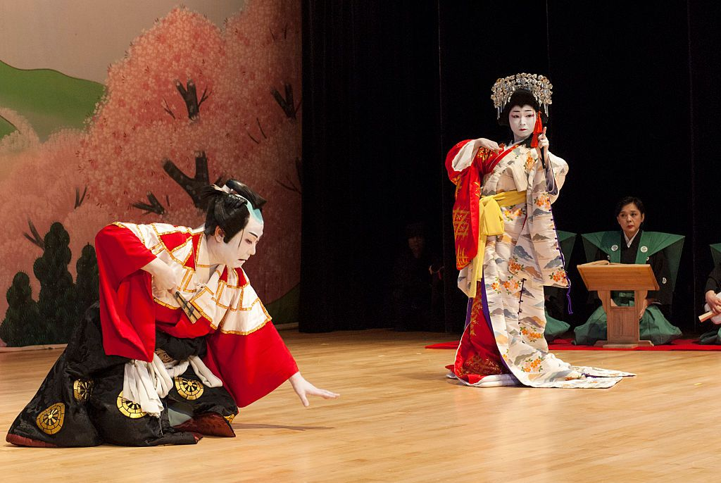 two kabuki performers performing on stage