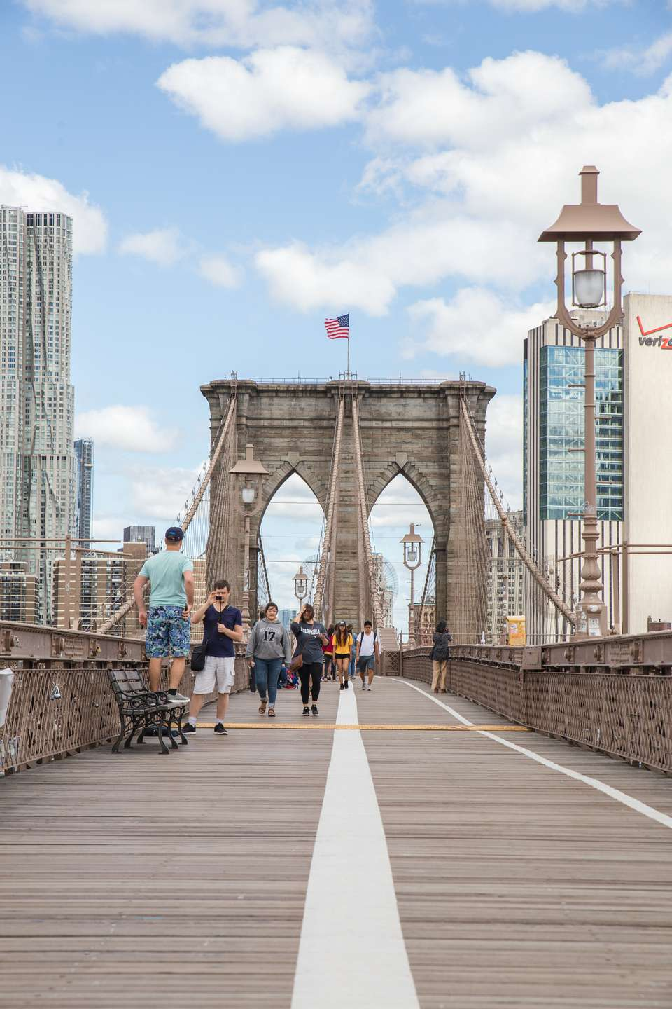 People walking along the Brooklyn Bridge