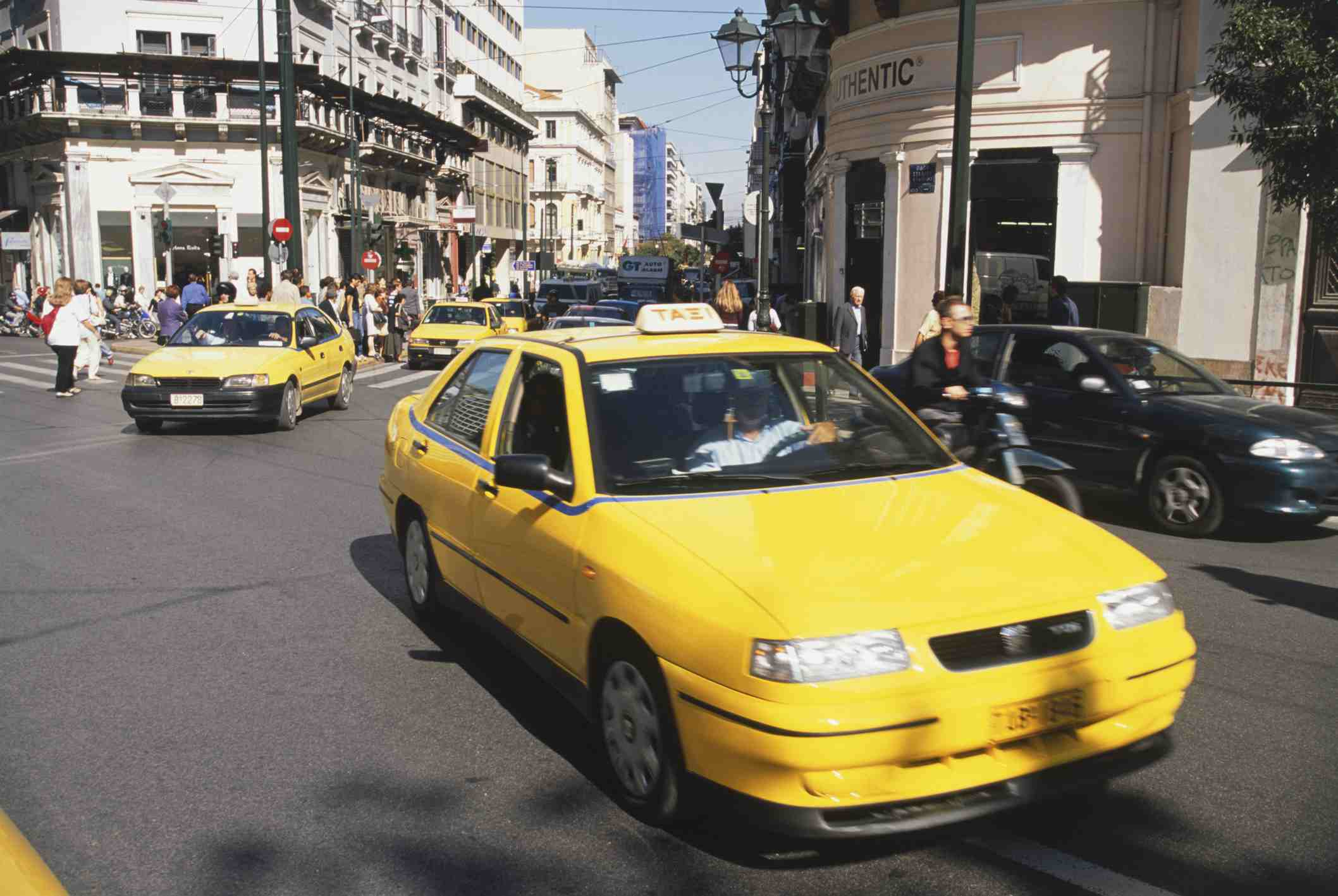 Yellow taxi cabs in heavy traffic in Athens, Greece