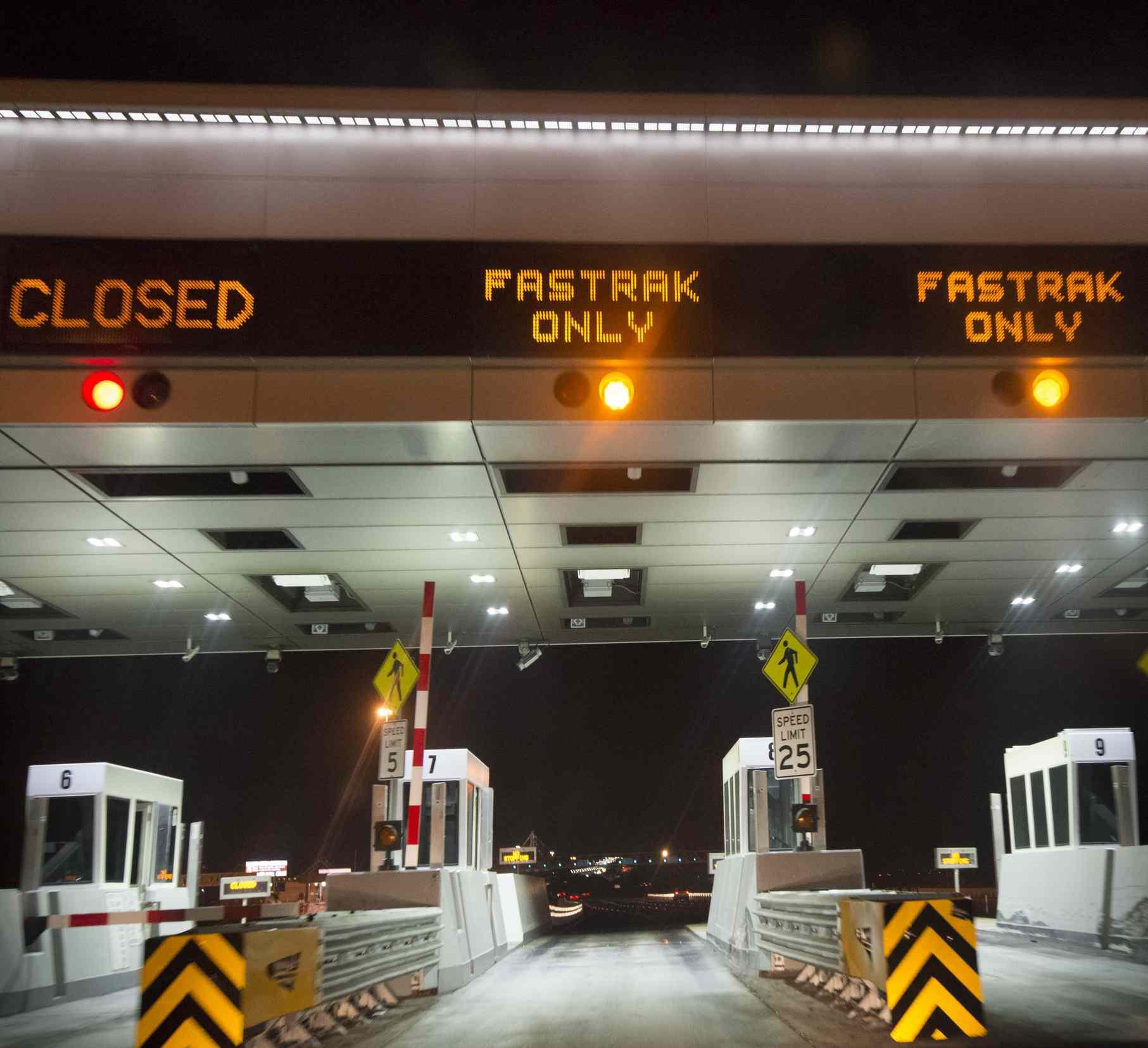 three toll booth lanes at night
