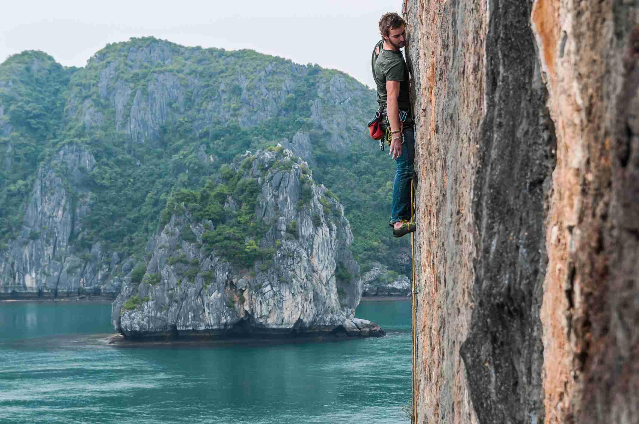 Deepwater soloing climber on Ha Long Bay, Vietnam