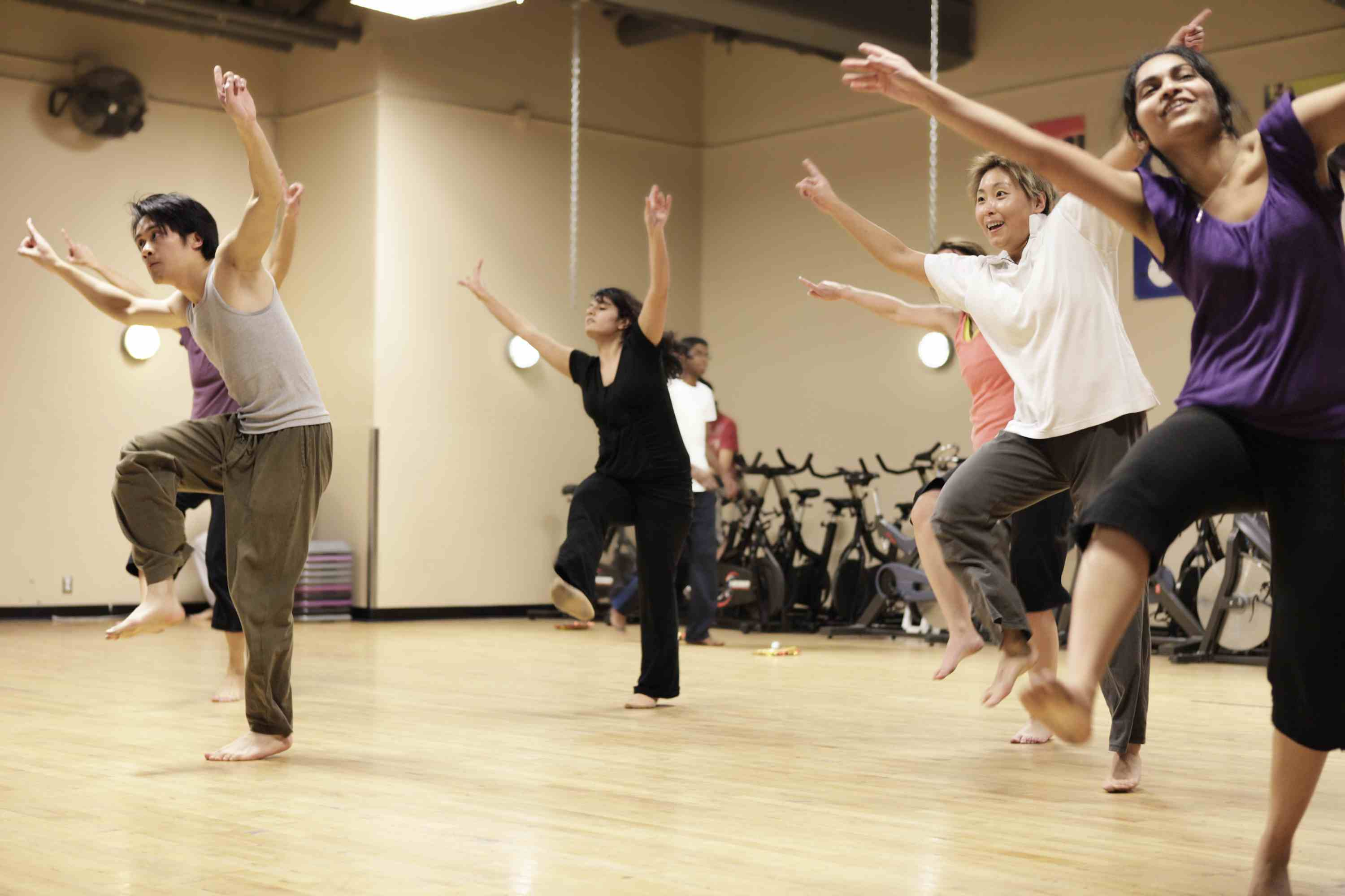 Dancers participating in a Bollywood dance lesson.
