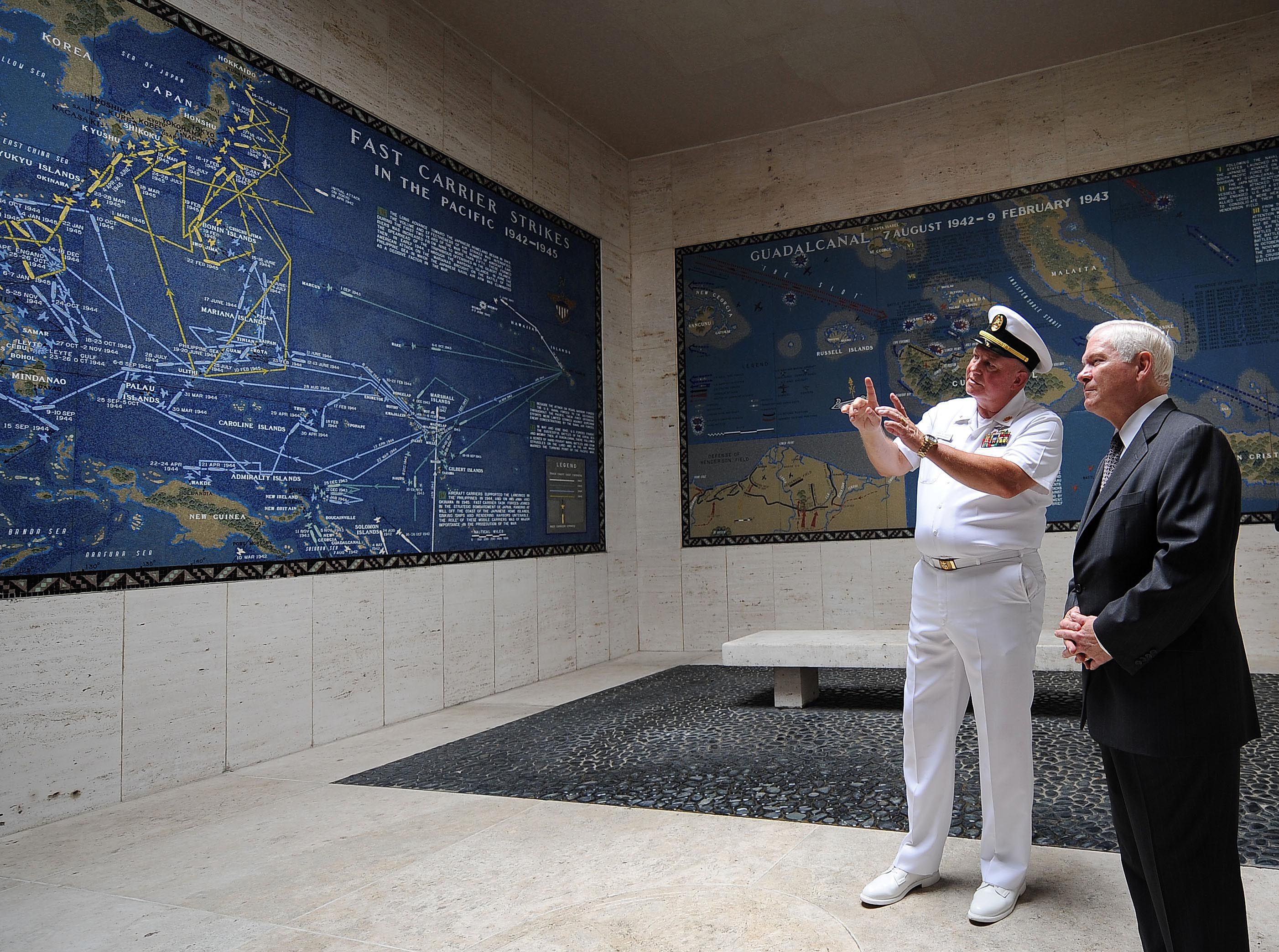 Secretary of Defense Robert M. Gates is shown around a Map Room by Larry Adkison, superintendent of the Manila American Cemetery.