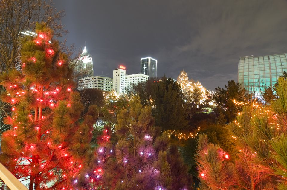 The Myriad Gardens lit up for the holidays, with the Oklahoma City skyline behind.