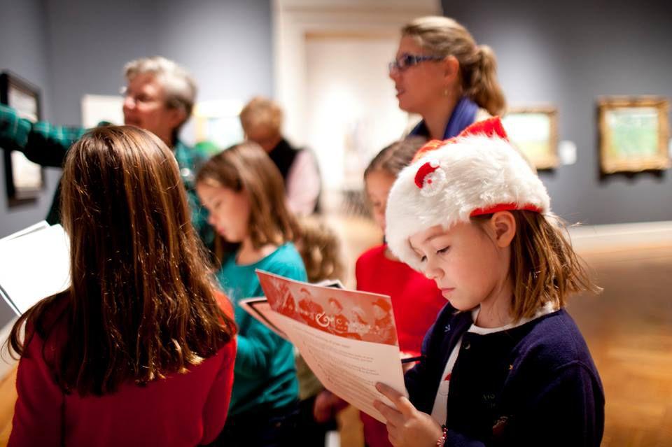 Kid wearing a santa hat at the Saint Louis Art Museum