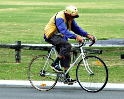 Cyclist riding near a city park