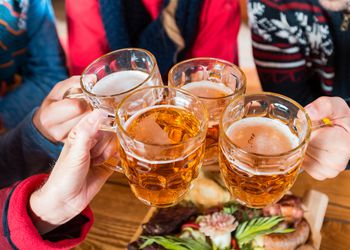 Friends toasting with beer