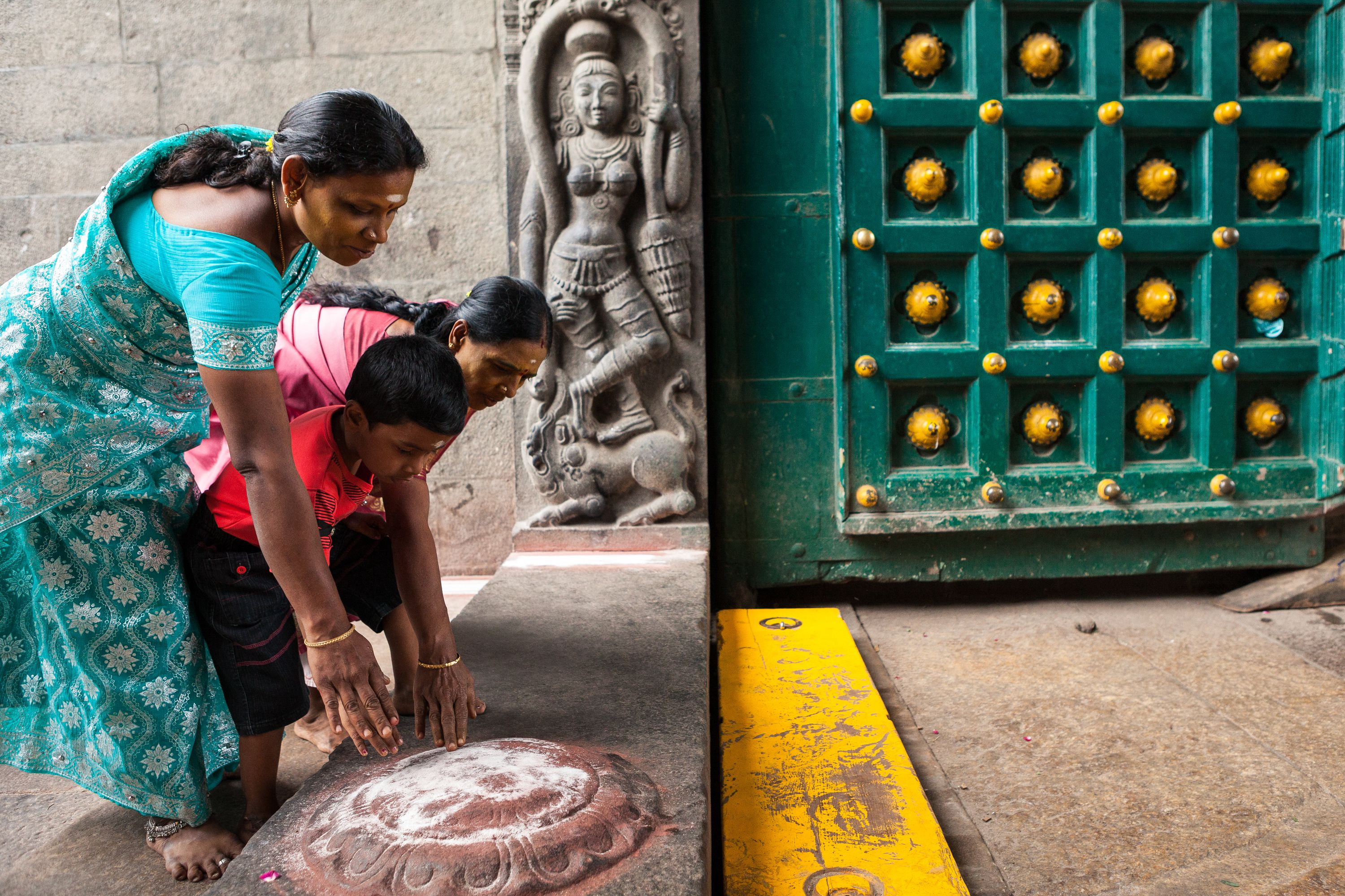Hindu pilgrims touching the ground at entrance of the Kapaleeshwarar Temple located in Mylapore, Chennai.