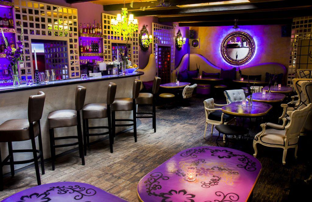 purple and black restaurants interior of Radost FX