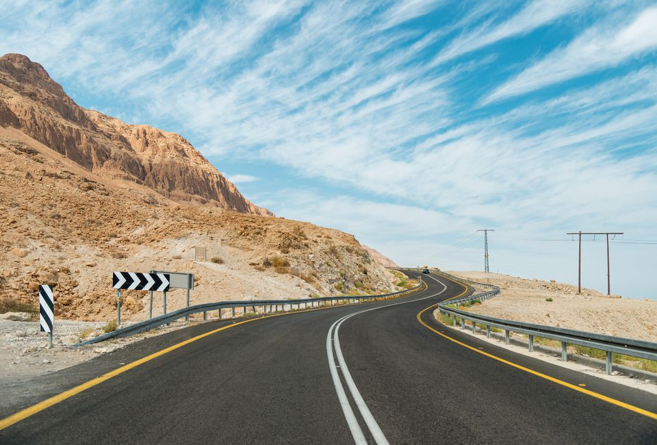 And empty, winding desert road in south Israel