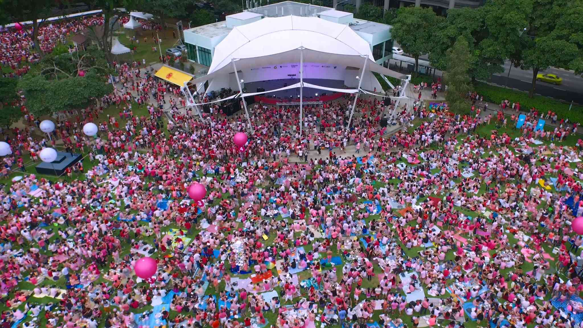 Aerial shot of people in pink gathering at the festival