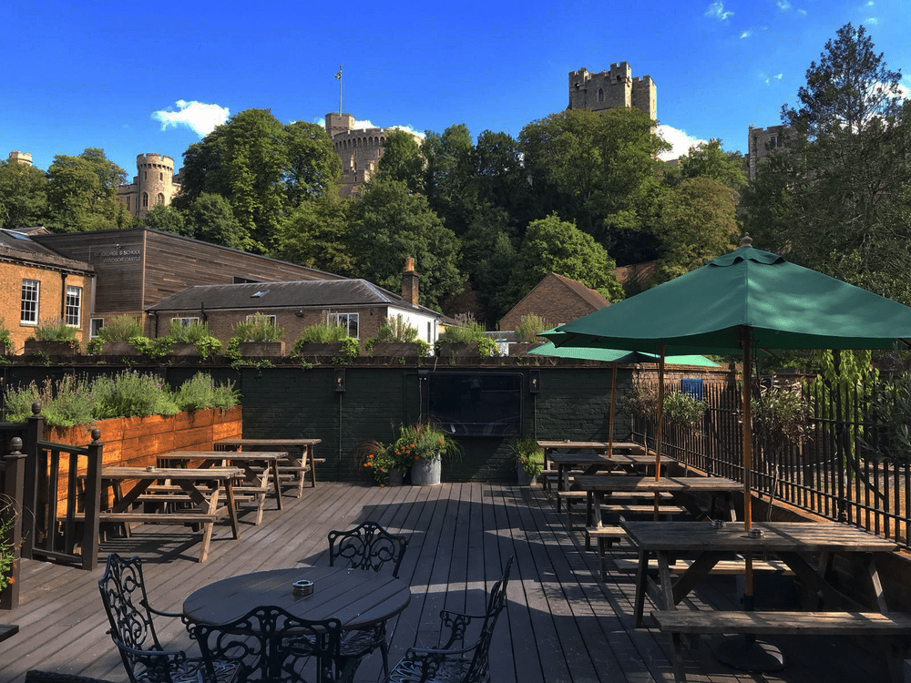 wooden deck with furniture with Windsor Castle on a hill overhead