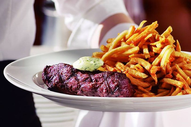 hanger steak served with julienne fries