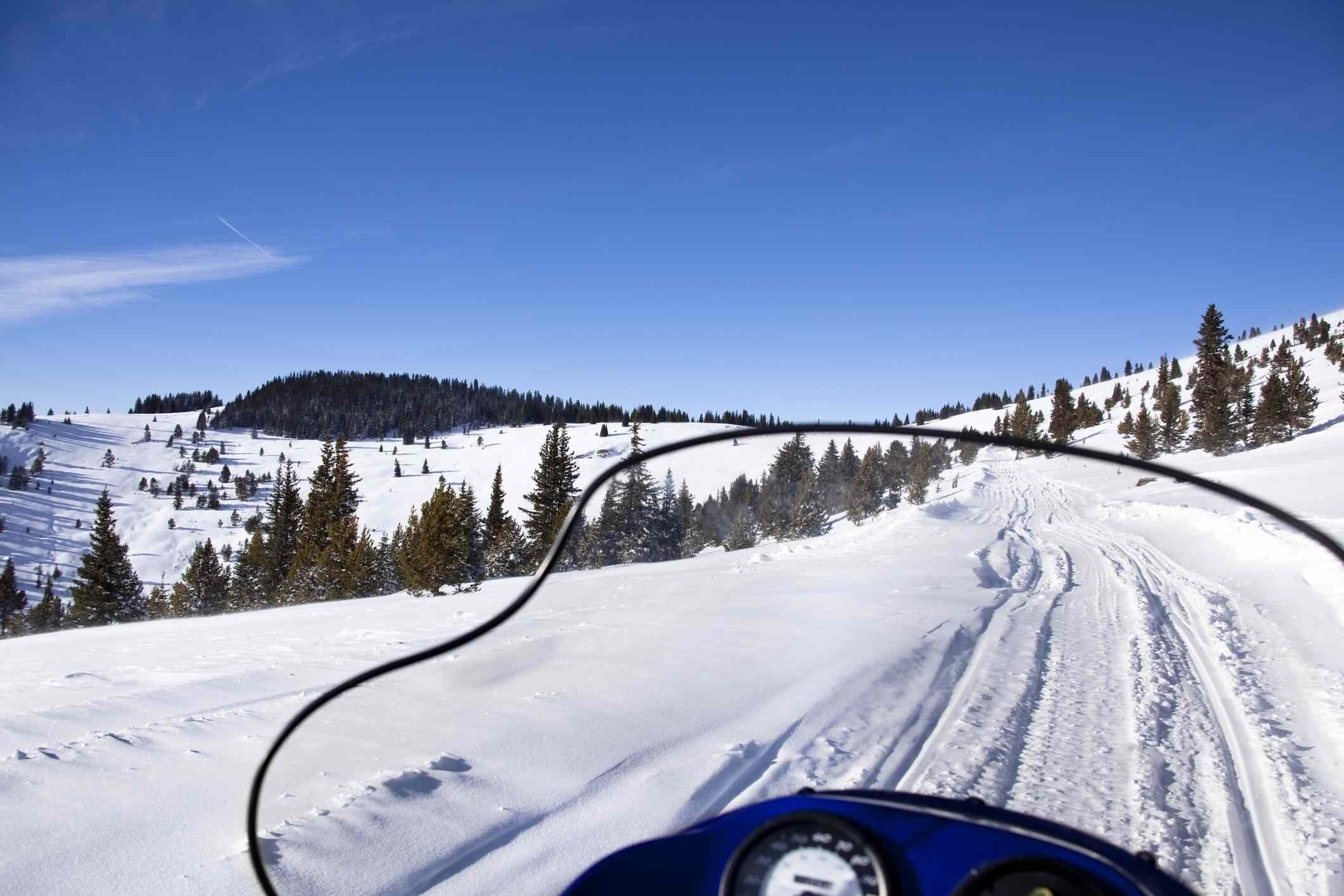 Snowmobiler on backcountry trails in Vail.