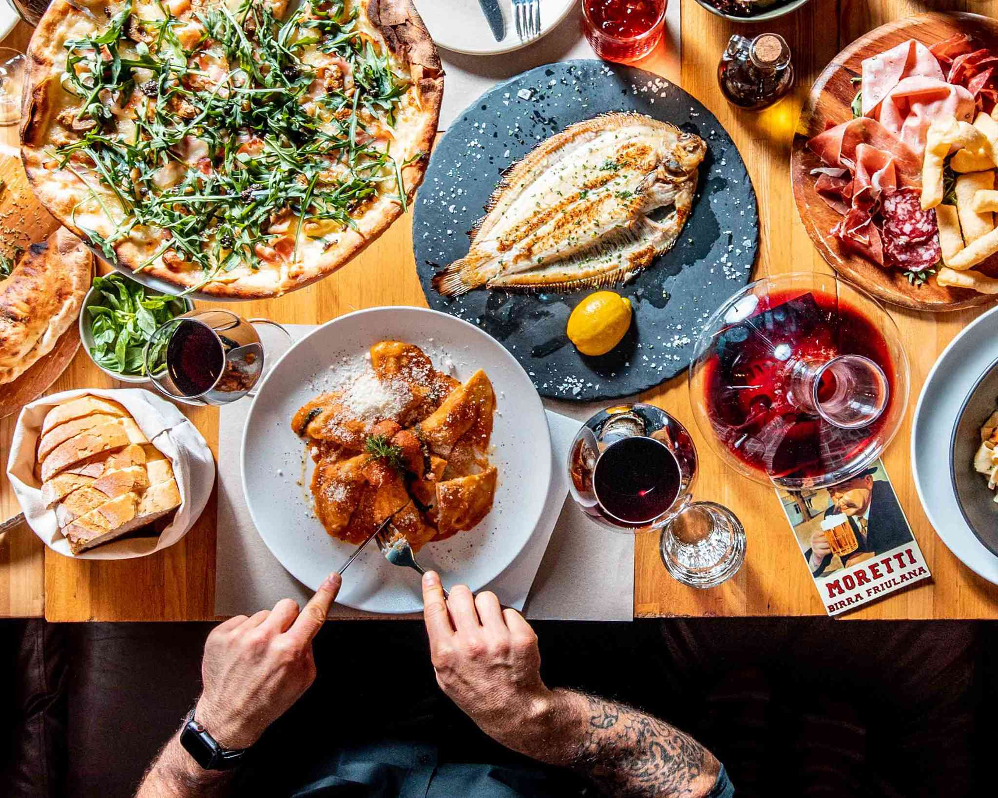 A table filled with Italian dishes