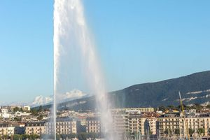 The Jet d'Eau fountain with Geneva cityscape in the background