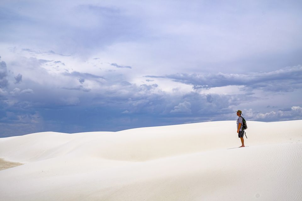 A man standing in White Sands National Park