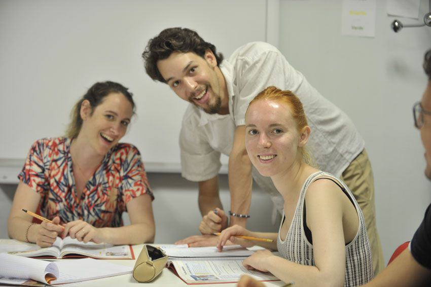 students learning in classroom with teacher